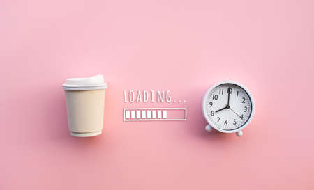 Drinking,refreshment in morning concepts with coffee cup and clock(watch) with loading text on color background.Business worker and time