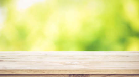 Empty wood table top on blur abstract green garden in the morning.For montage product display or design key visual layout Banco de Imagens