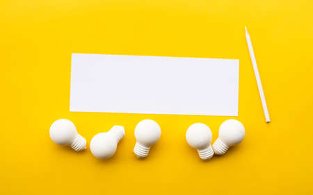 Business creativity / think outside the box concepts with lightbulb on yellow background.motivation for success.