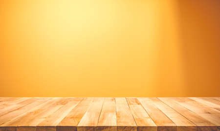 Empty of wood table top on yellow pastel color background.For montage product display or design key visual layout Archivio Fotografico