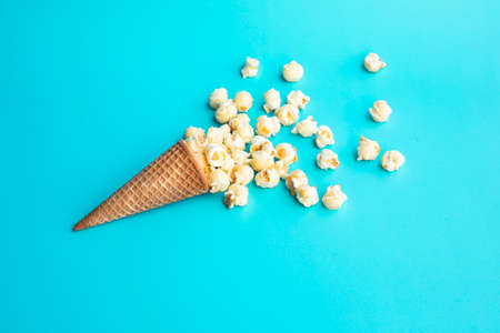 Pop corn with ice cream cone on pastel color background.Food and snack concepts ideas.Minimal style