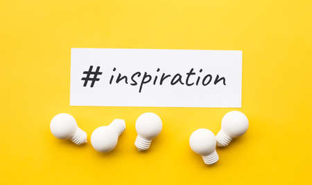 Business creativity with inspiration text and lightbulb on yellow background.motivation for success.think big ideas