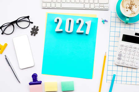 2021 text with modern accessories of worker on table background.creativity space Archivio Fotografico