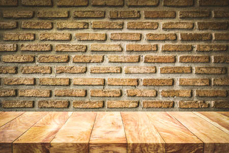 Empty wood table top with dark brick wall background.For create product display or design key visual layout