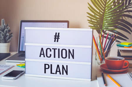 Action plan text on light box on desk table in home office.Business motivation or inspiration,performance of human concepts ideas Archivio Fotografico
