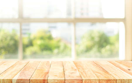 Empty wood table with blur  big window view background.For montage product display or design key visual layout.