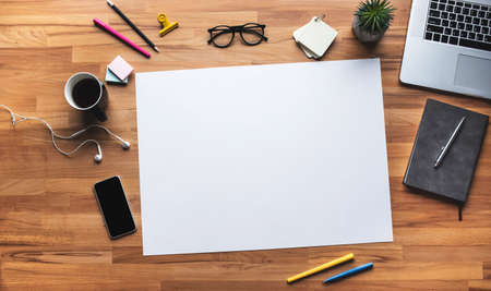 Top view of work table with white coppy space background.Business plan and management concepts Archivio Fotografico