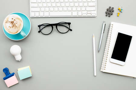 Modern accessories of worker on desk table background.creativity space Archivio Fotografico
