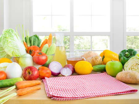 Selective focus on cloth/Set of variety vegetable with copy space on kitchen counter bar with window.Healthy eating with vegetarian concepts.For product display