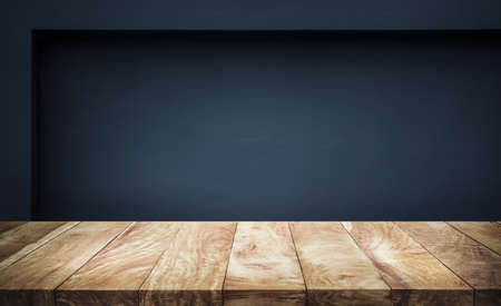 Empty wood table top with dark wall background.For create product display or design key visual layout