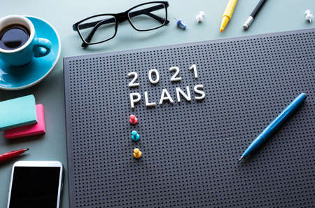 2021 plan with text on desk table.Business management.motivation to success concepts ideas