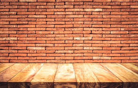 Empty wood table top with brown brick wall background.For create product display or design key visual layout 免版税图像