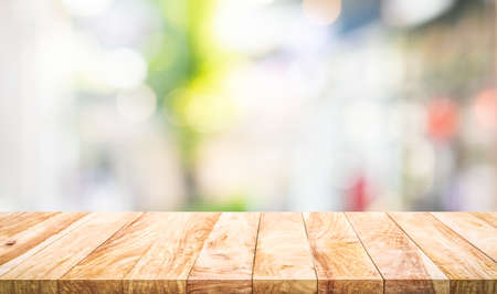 Empty wood table top on blur abstract  window glass view.For montage product display or design key visual layout 免版税图像