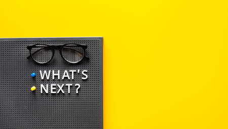 What's next ? text with glasses on work table.trends research and new things.business startup concepts 免版税图像