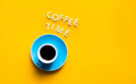 Coffee time text with cup on colorful background.refreshment and drink concepts