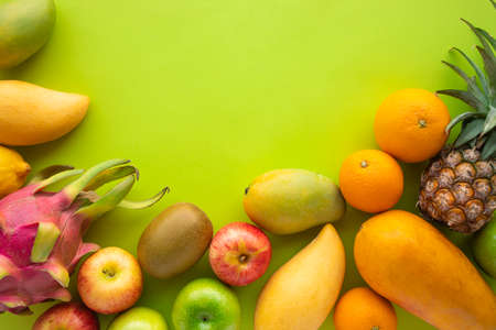 Group of fruits on green space background