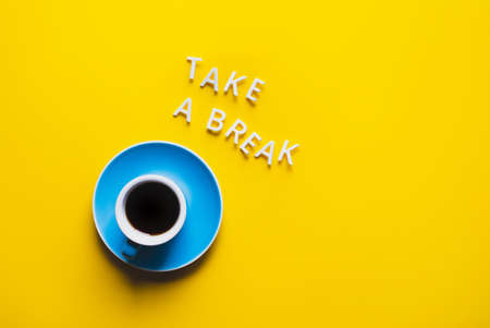Take a break text with cup on colorful background.refreshment and drink concepts 免版税图像