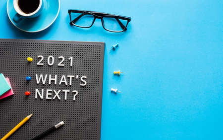2021 What's next ? text on work table.trends research and new things.business startup concepts 免版税图像