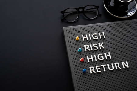 High risk high return text on desk.business motivation and growth concepts