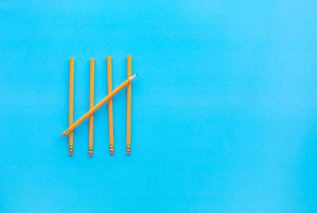 Yellow pencil on blue background.For business idea and education concept.