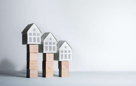Real estate concepts with model house on wood box.business investment and  plan 免版税图像