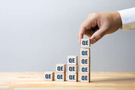 Quantitative easing or economy concepts with qe sign Increase.crisis and solution