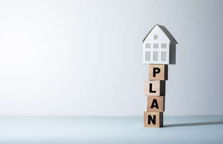 Real estate or property concepts with plan text and model house.business investment and financial. 免版税图像