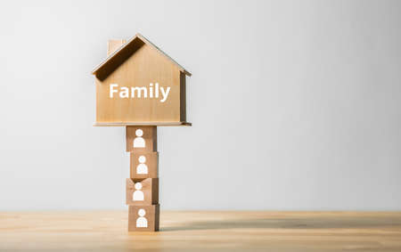 Family and community concepts with wood house model.business property and insurance.copy space