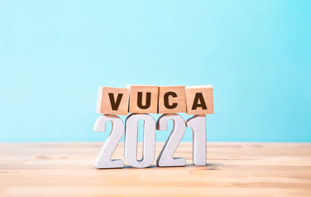 2021 vuca world concepts with text on wood block.vision and Change.copy space