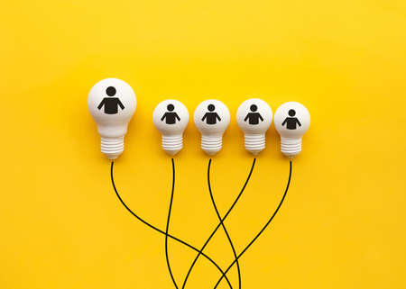Business creativity and leadership concepts with lightbulb on yellow background.motivation for success.think big ideas
