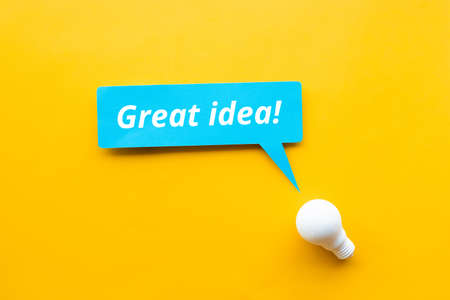 Great idea! / Business creativity concepts with lightbulb on yellow background.motivation for success. 免版税图像