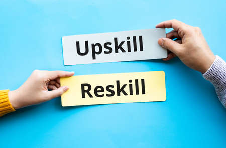 Up skill and re skill text on bubble paper.performance or development of person concepts ideas