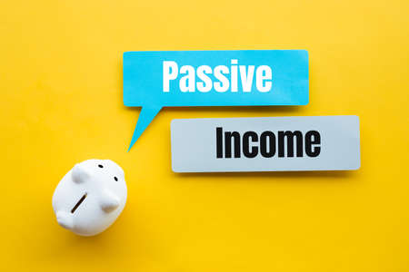 Passive income and investment financial concepts with text and piggy bank.no people