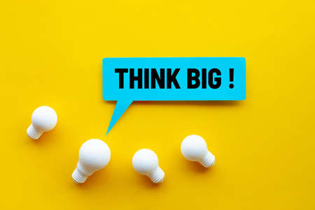 Think big,Great idea,Business creativity concepts with lightbulb and text on yellow background.motivation for success.
