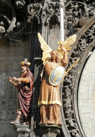 Prague, Czech Republic - July 31, 2012: Wooden statues of Philosopher and Archangel Michael. They are part of Prague Astronomical Clock.