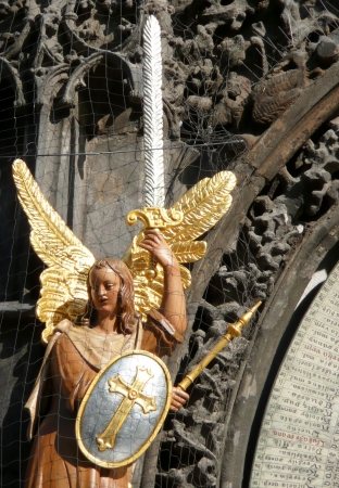 Prague, Czech Republic - July 31, 2012: Wooden statue of  Archangel Michael from Prague Astronomical Clock.