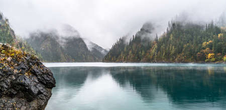 tree  forest: Calm forest smooth lake with reflections, china juzhaigou Stock Photo