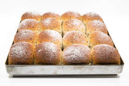 pastry crust: delicious breads with sesame seeds on the baking pan