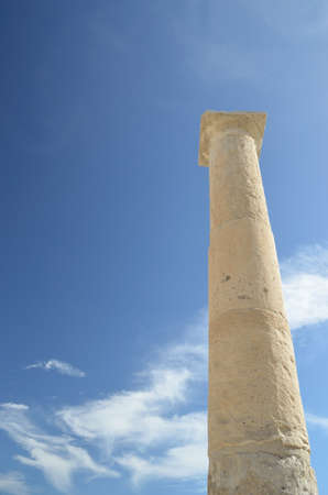 Ancient column set against a blue sky photo