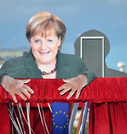 """cardboard cutout: Cipro 26 marzo 2013, il Carnevale galleggiante con la sagoma di cartone di Angela Merkel come il """"burattinaio"""" EU"""