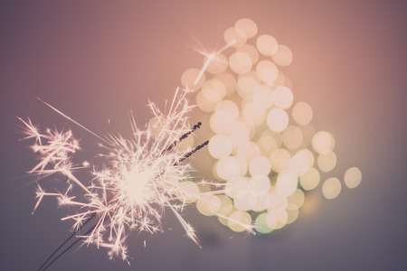 atmospheric: Sparklers and light bokeh Stock Photo