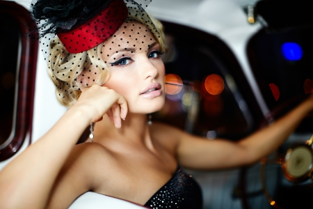 old fashion: High fashion look glamor closeup portrait of beautiful sexy stylish blond  girl model with bright makeup in retro style sitting in old car Stock Photo