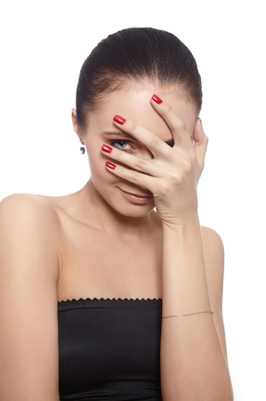 Shy woman covering her face with her hand isolateed on white photo