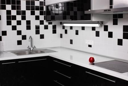 kitchen design: interior of black and white modern kitchen with red tasty apple