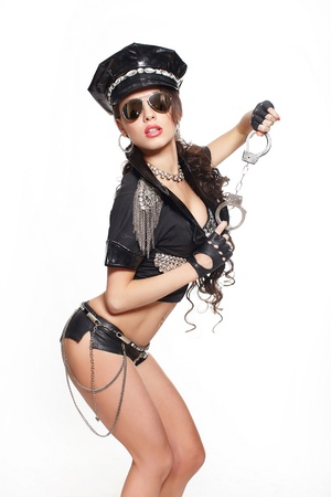 semi nude: sexy beautiful  brunette semi nude police woman with long curly hair with handcuffs in glasses with birght makeup and red lips isolated on white