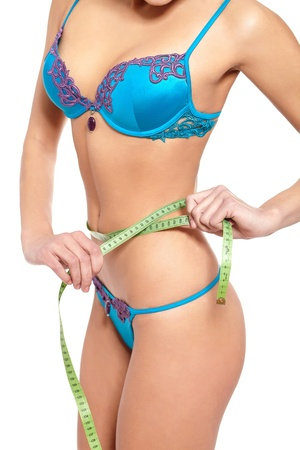 woman in blue lingerie measuring  shape isolated on white photo