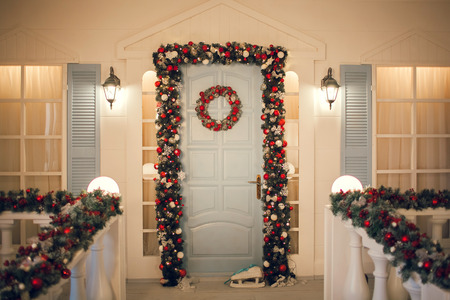 beautiful festive Christmas facade with porch and decoration