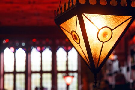 Magic triangular lamp in the ancient library, dim light, mysterious place, stained glass windows, place for text, secret passage 写真素材