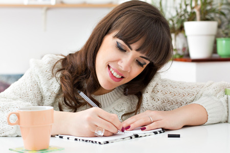 Young woman writing ideas