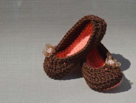 crocheted: Girls Crocheted Slippers Stock Photo